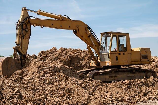 Excavator Digging in dirt.
